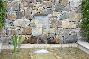 garden rock wall with pond